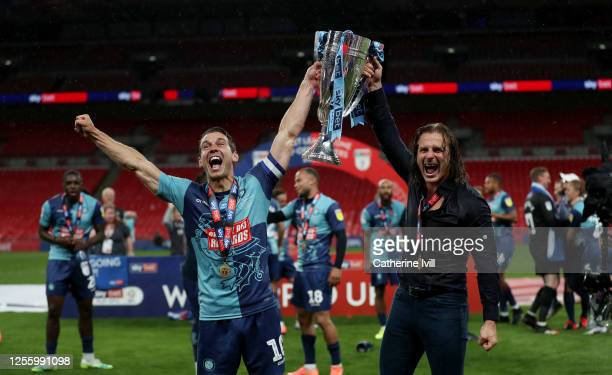 Matthew Bloomfield of Wycombe Wanderers and Gareth Ainsworth the manager of Wycombe Wanderers celebrate after the Sky Bet League One Play Off Final...