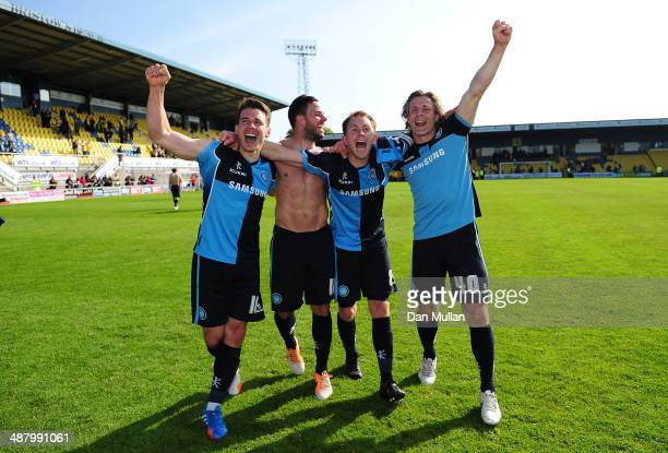 Matthew Bloomfield Sam Wood Stuart Lewis and Gareth Ainsworth Manager of Wycombe Wanderers celebrate after the final whistle as their team avoid...