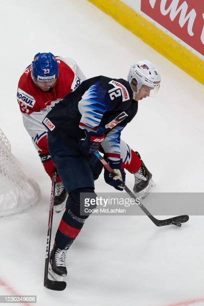 Matthew Boldy of the United States skates against Simon Kubicek of the Czech Republic during the 2021 IIHF World Junior Championship at Rogers Place...