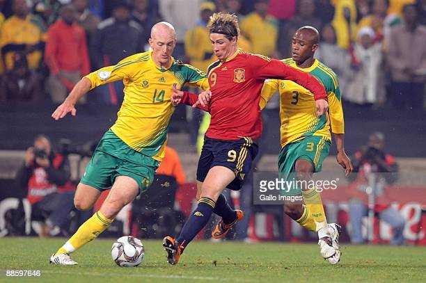 Matthew Booth of South Africa Fernando Torres of Spain and Tshepo Masilela of South Africa in action during the FIFA Confederations Cup match between...