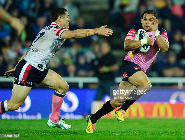 Matthew Bowen of the Cowboys runs past Luke O'Donnell of the Roosters during the round 10 NRL match between the North Queensland Cowboys and the...