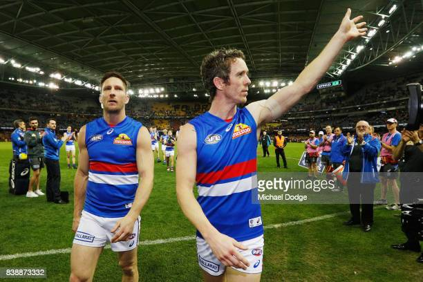 Matthew Boyd and Robert Murphy of the Bulldogs waves to fans after losing their retirement match during round 23 AFL match between the Hawthorn Hawks...