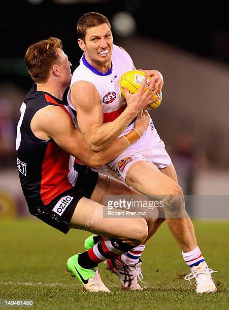 Matthew Boyd of the Bulldogs is tackled by Brendon Goddard of the Saints during the round 18 AFL match between the St Kilda Saints and the Western...