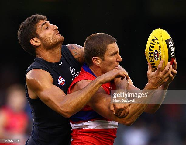 Matthew Boyd of the Bulldogs marks in front of Paul Bower of the Blues during the round two NAB Cup AFL match between the Western Bulldogs and the...