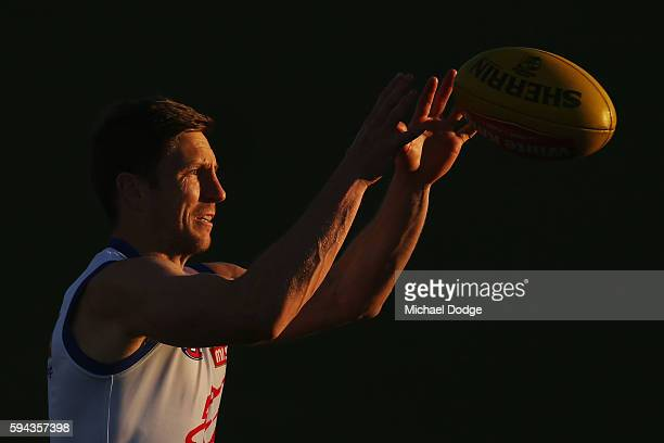 Matthew Boyd of the Bulldogs marks the ball during a Western Bulldogs AFL training session at Whitten Oval on August 23 2016 in Melbourne Australia