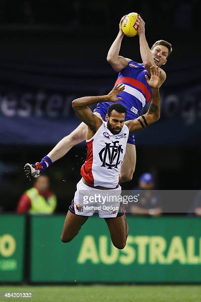 Matthew Boyd of the Bulldogs marks the ball over Heritier Lumumba of the Demons during the round 20 AFL match between the Western Bulldogs and...