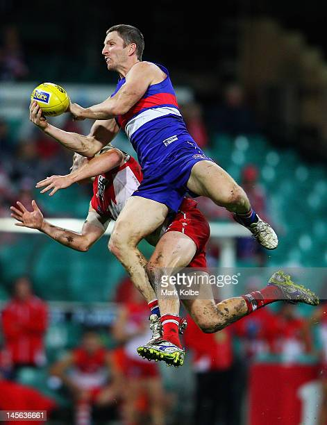 Matthew Boyd of the Bulldogs wins the ball from Daniel Hannebery of the Swans during the round 10 AFL match between the Sydney Swans and the Western...