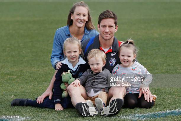 Matthew Boyd poses with his kids and wife Kate after announcing his retirement sduring a Western Bulldogs AFL press conference at Whitten Oval on...