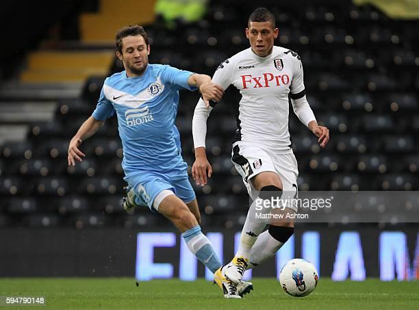 Matthew Briggs of Fulham and Denys Kulakov of FC Dnipro