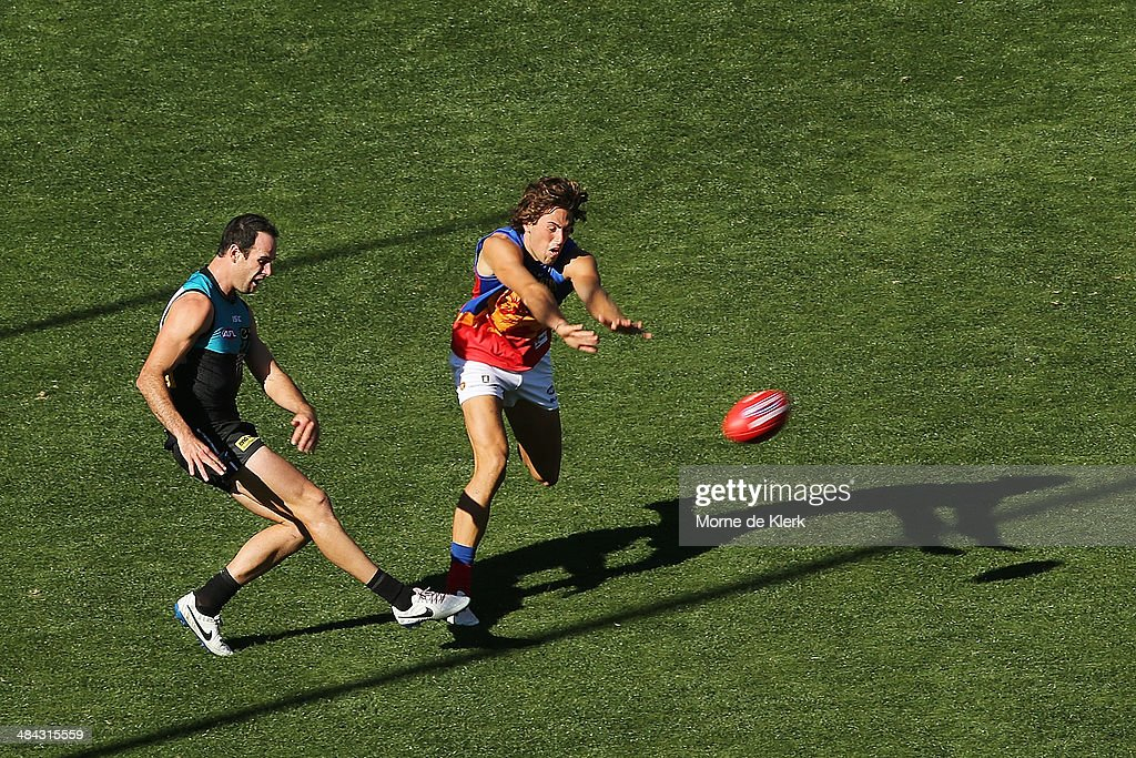 Matthew Broadbent of the Power kicks the ball during the round 4 AFL game between Port Adelaide and the Brisbane Lions at Adelaide Oval on April 12, 2014 in Adelaide, Australia.
