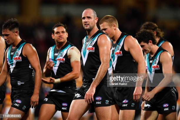 Matthew Broadbent of the Power looks on dejected at half time during the round eight AFL match between the Port Adelaide Power and the Adelaide Crows...