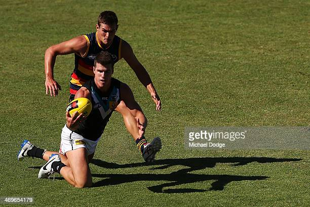 Matthew Broadbent of the Power marks the ball during the round two AFL NAB Challenge Cup match between the Adelaide Crows and the Port Adelaide Power...