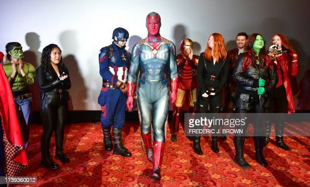 Matthew Bruhm dressed as Vision steps forward as fans of the Avengers take part in a costume contest before the first screening of Avengers Endgame...
