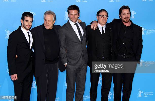 Matthew Budman producer Charles Roven actor Bradley Cooper director David O Russell and actor Christian Bale attend the 'American Hustle' photocall...