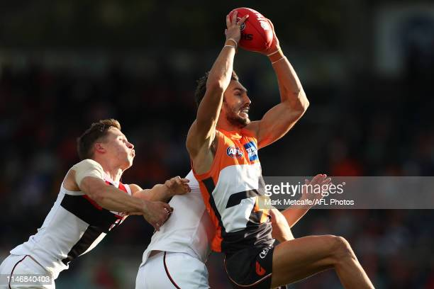 Matthew Buntine of the Giants takes a mark during the round seven AFL match between the Greater Western Sydney Giants and the St Kilda Saints at...