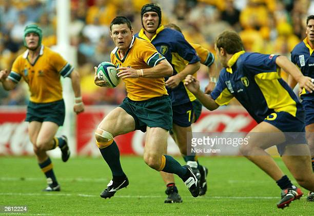 Matthew Burke in action during the Rugby World Cup Pool A match between Australia and Romania at Suncorp Stadium October 18, 2003 in Brisbane,...