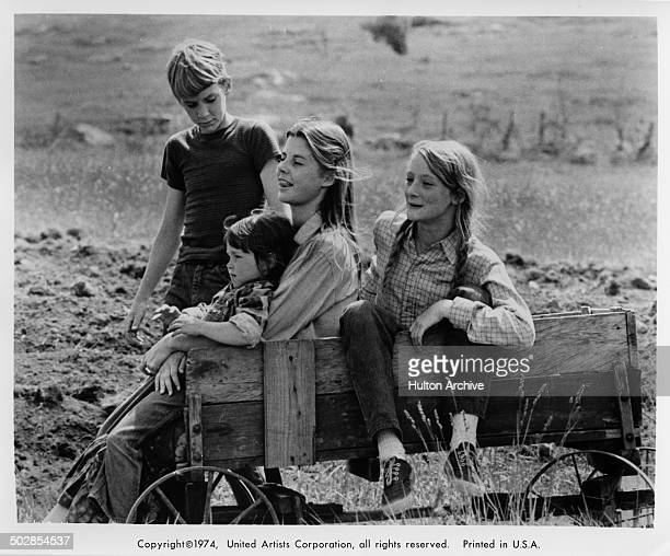 Matthew Burrill Helen Harmon Jan Smithers and Julie Gholson sit in a wagon in a scene from the United Artist movie Where the Lilies Bloom circa 1974