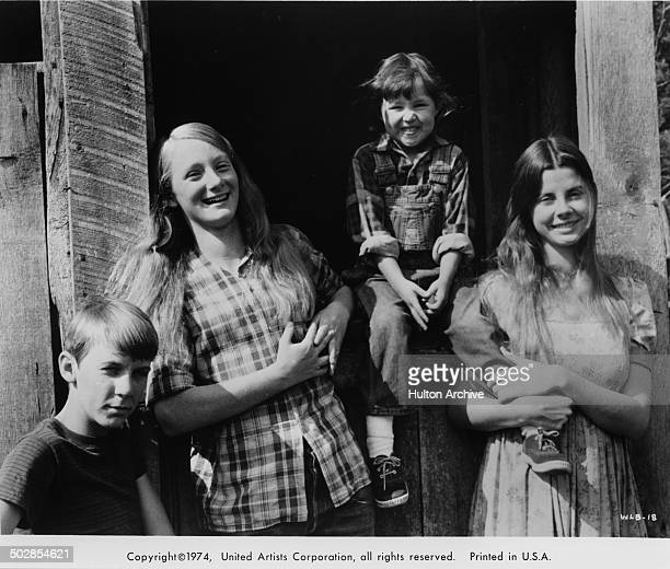 Matthew Burrill Julie Gholson Helen Harmon Jan Smithers pose for the United Artist movie Where the Lilies Bloom circa 1974