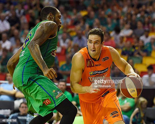 Matthew Burston of the Taipans drives to the basket past Mickell Gladness of the Crocodiles during the round 14 NBL match between the Townsville...
