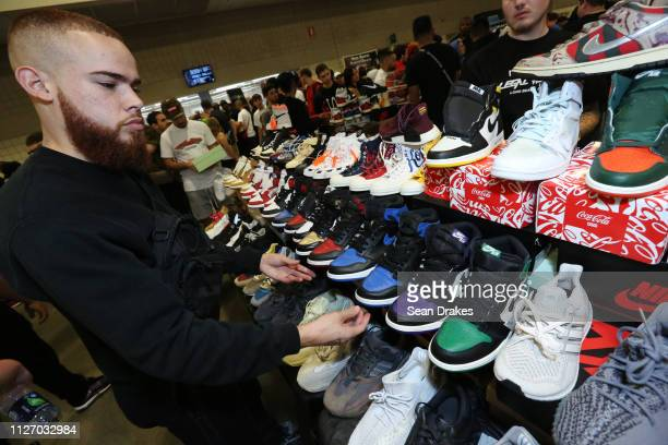 Matthew Caraballo organizes his sneaker display during SneakerCon 2019 at Fort Lauderdale Convention Center on February 2 2019 in Fort Lauderdale...