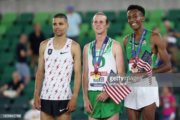 Matthew Centrowitz, Cole Hocker, and Yared Nuguse pose on the podium after competing in the Men's 1,500 Meter Run Final during day ten of the 2020...