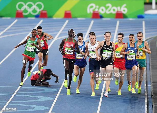 Matthew Centrowitz of the United States Nicholas Willis of New Zealand and Asbel Kiprop of Kenya compete during the Men's 1500 meter Final on Day 15...