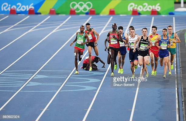 Matthew Centrowitz of the United States, Nicholas Willis of New Zealand and Asbel Kiprop of Kenya compete during the Men's 1500 meter Final on Day 15...