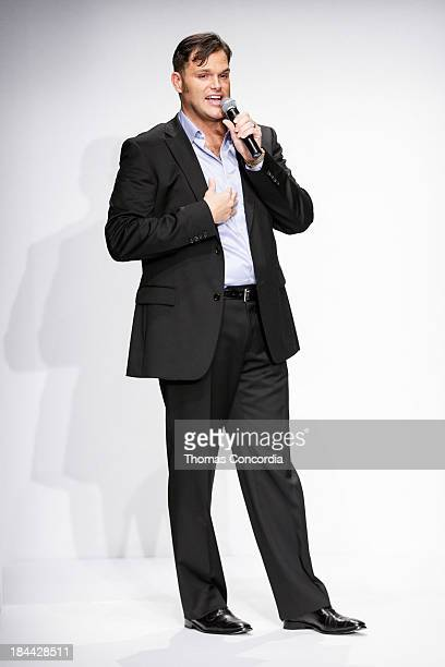 Matthew Christopher thanks the audience after the Matthew Christopher Couture Fall 2014 Bridal collection show at the Hilton New York on October 13,...