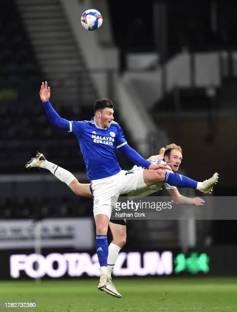 Matthew Clarke of Derby County and Kieffer Moore of Cardiff City compete for the ball during the Sky Bet Championship match between Derby County and...