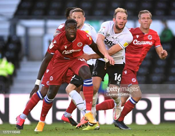 Matthew Clarke of Derby County and Lucas Joao of Reading FC battle during the Sky Bet Championship match between Derby County and Reading at Pride...