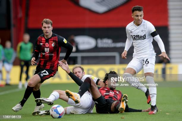 Matthew Clarke of Derby County clears from Philip Billing of Bournemouth during the Sky Bet Championship match between AFC Bournemouth and Derby...