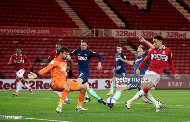 Matthew Clarke of Derby County diverts the shot of Marcus Tavernier of Middlesbrough to score an own goal during the Sky Bet Championship match...