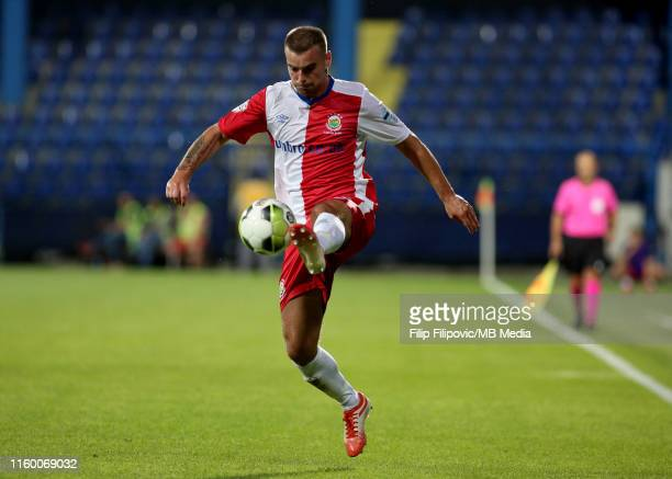 Matthew Clarke of Linfield controls the ball during the UEFA Europa League third round qualifier match between Sutjeska Niksic and Linfield FC on...