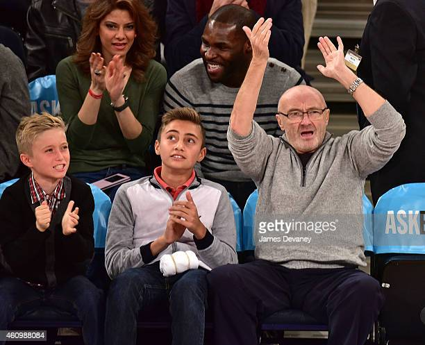 Matthew Collins Nicholas Collins and Phil Collins attend the Detroit Pistons vs New York Knicks game at Madison Square Garden on January 2 2015 in...