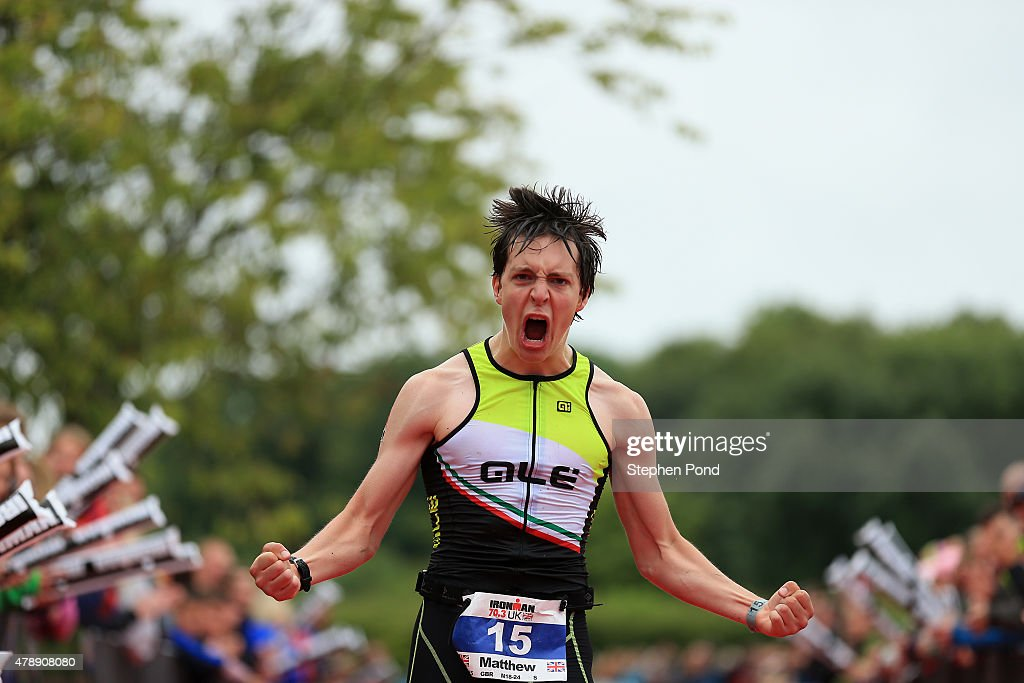 Matthew Collyer of Great Britain reacts as he finishes the Ironman 70.3 Exmoor event on June 28, 2015 in Exmoor National Park, England.