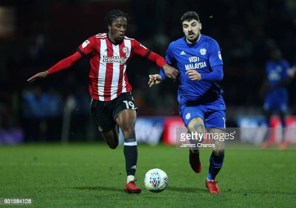 Matthew Connolly of Cardiff City battles for possesion with Romaine Sawyers of Brentford during the Sky Bet Championship match between Brentford and...