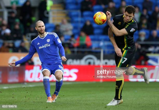 Matthew Connolly of Cardiff City crosses the ball into the box past Yanic Wildschut of Norwich City during the Sky Bet Championship match between...