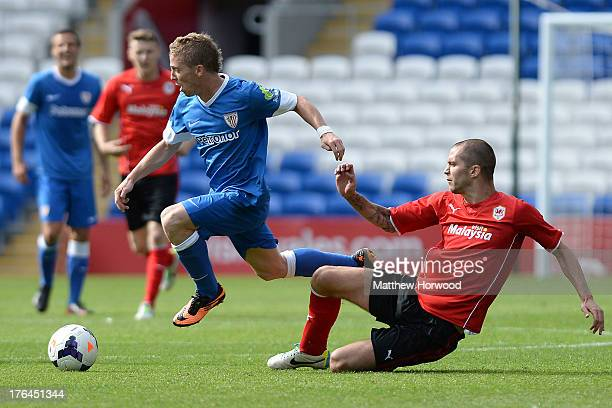 Matthew Connolly of Cardiff City goes in for the tackle with Athletic Club de Bilbao's Iker Muniain during the Pre Season Friendly match between...