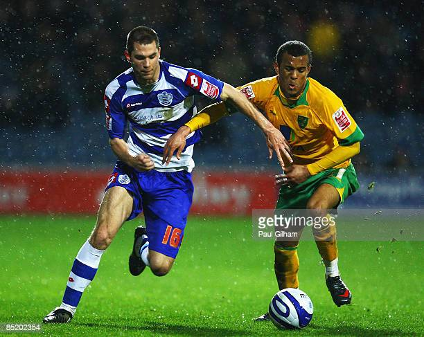 Matthew Connolly of Queens Park Rangers battles for the ball with Ryan Bertrand of Norwich City during the CocaCola Championship match between Queens...