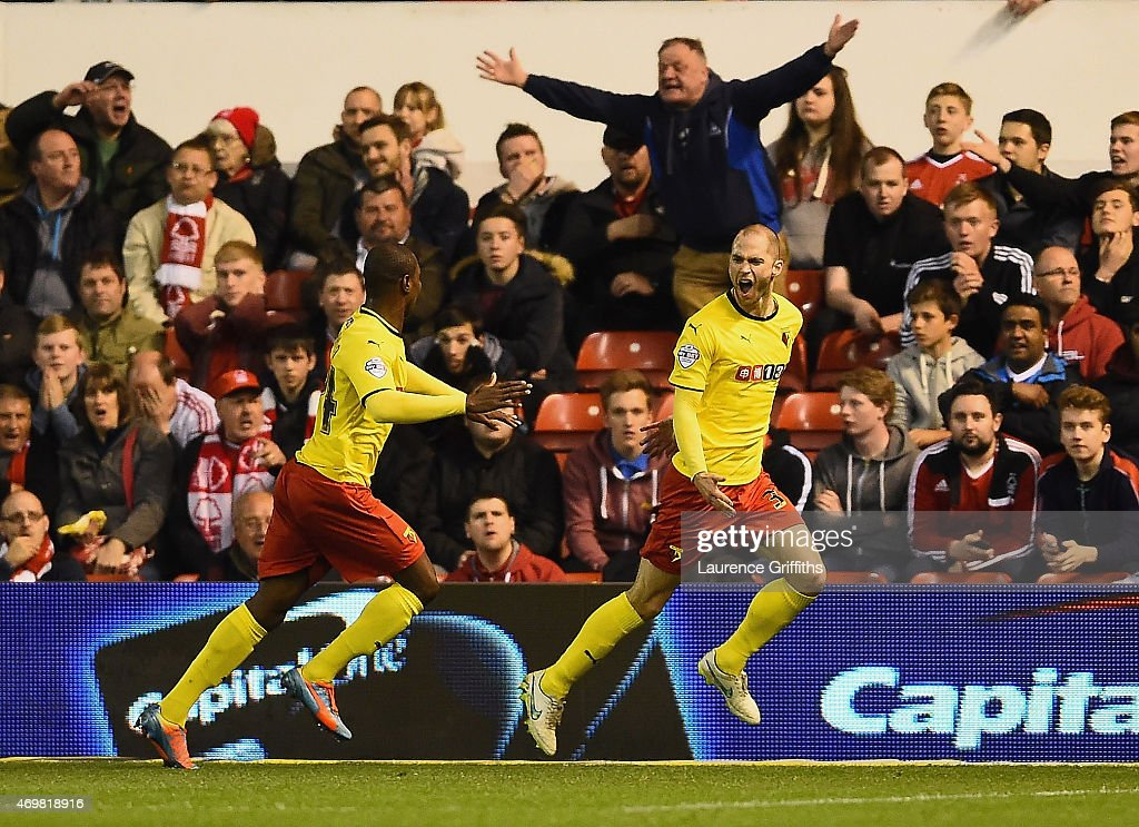 Matthew Connolly of Watford celebrates scoring their second goal with Odion Ighalo of Watford (R) during the Sky Bet Championship match between Nottingham Forest and Watford at City Ground on April 15, 2015 in Nottingham, England.