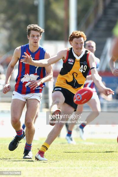 Matthew Cottrell of Dandenong kicks during the 2018 TAC Cup Grand Final match between Dandenong and Oakleigh at Ikon Park on September 22 2018 in...