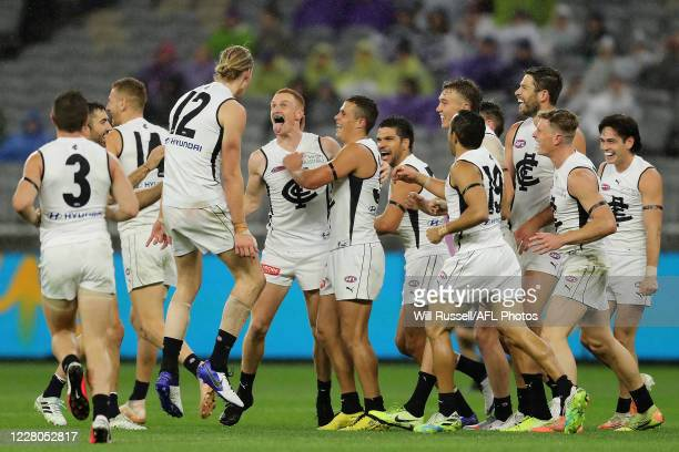 Matthew Cottrell of the Blues celebrates after scoring a goal during the 2020 AFL Round 12 match between the Fremantle Dockers and the Carlton Blues...