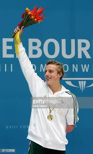 Matthew Cowdrey of Australia poses with his gold medal after the men's 50 metres disabled freestyle final at the Melbourne Sports Aquatic Centre...