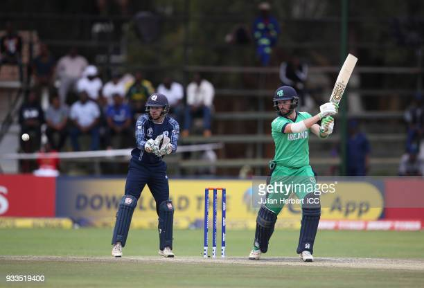 Matthew Cross of Scotland looks on as Andrew Balbirnie of Ireland scores runs during The ICC Cricket World Cup Qualifier at The Old Hararians Ground...