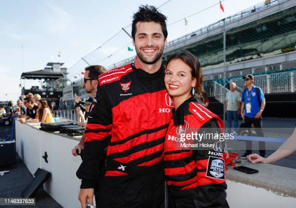 Matthew Daddario and his wife Esther Kim are seen after completing the IndyCar Experience at Indianapolis Motor Speedway on May 25 2019 in...