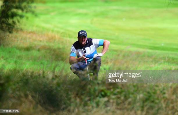 Matthew Daley of Hainsworth Park Golf Club checks his line before playing his second shot on the 1st fairway during Day Two of the Galvin Green PGA...