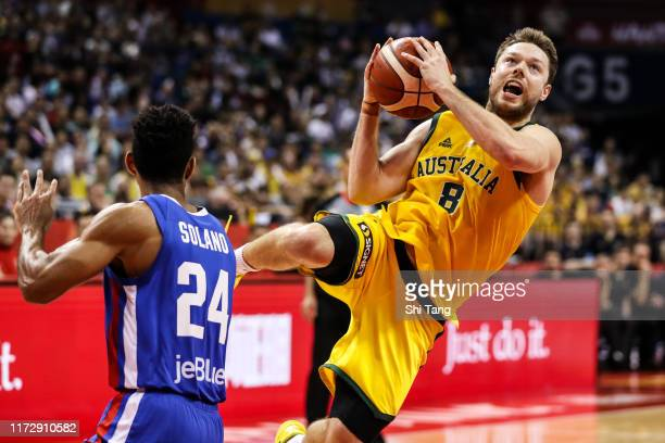 Matthew Dellavedova of Australia in action against Gelvis Solano of Dominican Republic during 2nd round Group L match between Australia and Dominican...