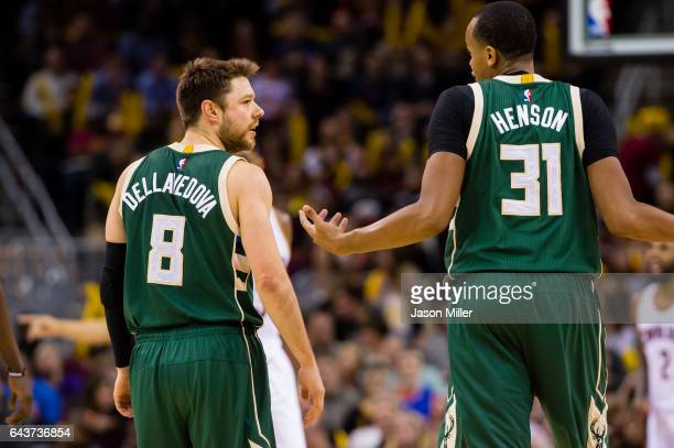 Matthew Dellavedova and John Henson of the Milwaukee Bucks talk between plays during the second half against the Cleveland Cavaliers at Quicken Loans...