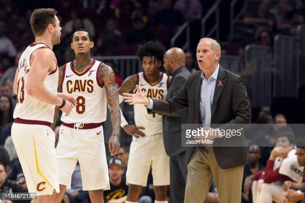 Matthew Dellavedova and Jordan Clarkson listen to head coach John Beilein of the Cleveland Cavaliers during the first half against the Chicago Bulls...