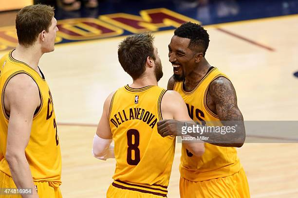 Matthew Dellavedova and JR Smith of the Cleveland Cavaliers celebrate after a play in the fourth quarter against the Atlanta Hawks during Game Four...